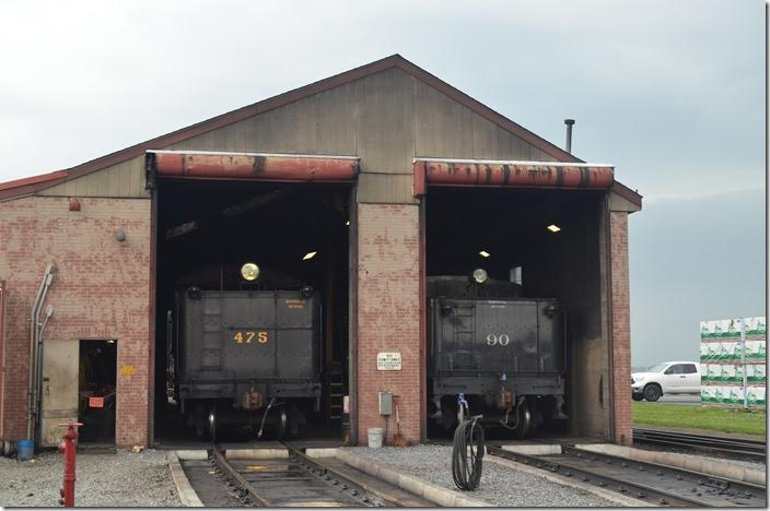 That stack of lumber on the right is the hint that SRR is a common carrier also. It is unloaded from rail and stored until the customer needs it. Strasburg engine house.