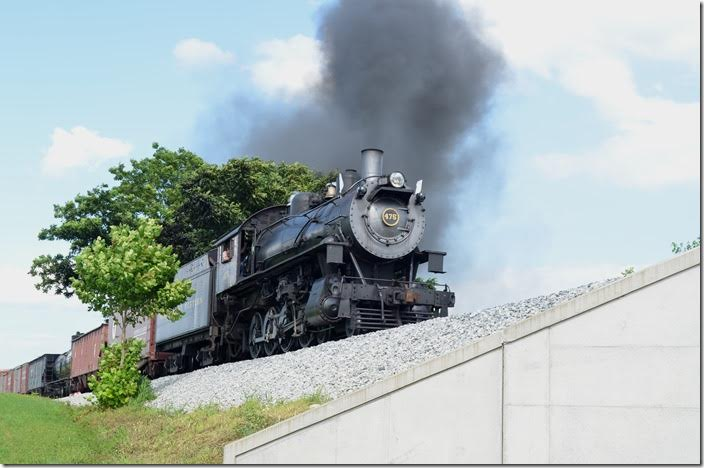Reminiscent of a N&W mixed train on the Abingdon Branch, former N&W 4-8-0 475 crosses a farm lane overpass at Groffs PA, on the Strasburg Railroad. N&W 475. Groffs PA