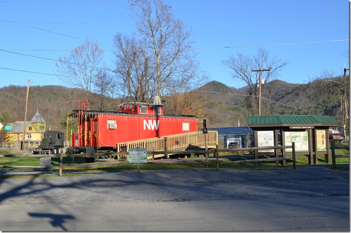 This former Wheeling & Lake Erie caboose is sitting beside the old roadbed. To the right is the Damascus city park. NW caboose 557758. Damascus VA.