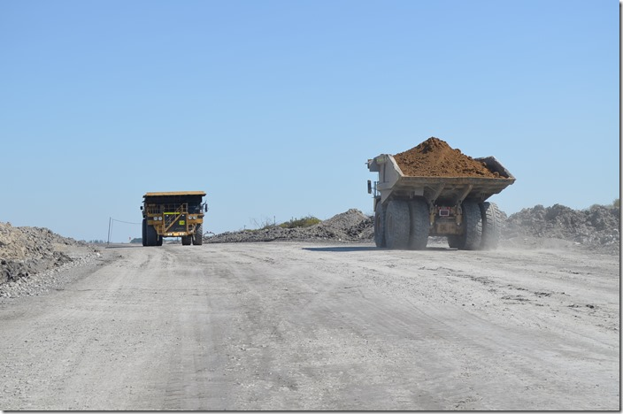 The topsoil carried by the truck on the left will be used for reclamation.