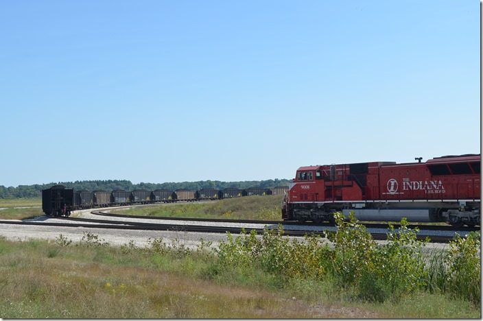 INRD 9008 is slowly moving forward on a track parallel to the IP&L train.