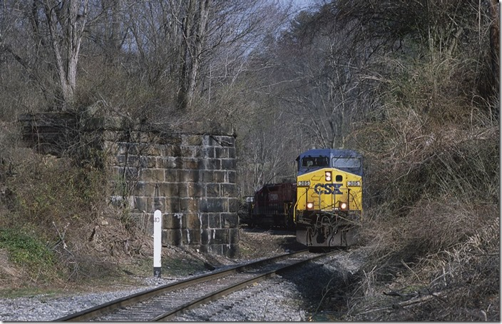 CSX 385-874-RJC 8718-8569 approach the abutments of the former C&O Price Hill Subdivision that went to the Mount Hope depot.