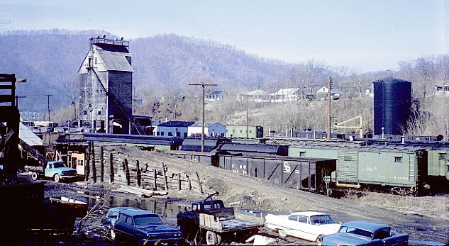 "Coal tipple, camp cars, car shop, coal dock and ""The Knoll"". 3-7-70. View 1."