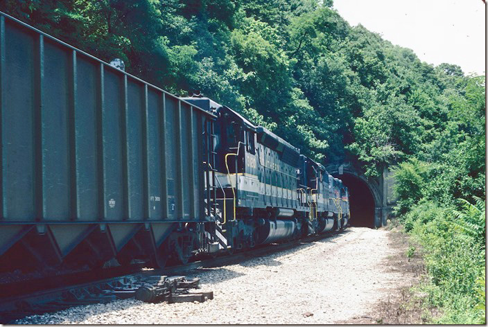 L&N (SBD) 8145-Sou 3178-3120 head south with the SMEX (South Mississippi Electric Power Assoc.) coal train for Purvis MS. This train loaded at the Alamo mine near Pineville KY on the L&N. This train had a L&N caboose. 06-18-1982.