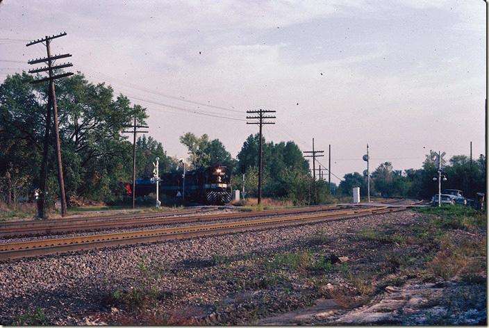 Westbound local #72 approaches the BN (former CB&Q) crossing at Centralia IL. 09-25-1981.