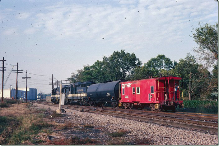 I believe the Southern got on BN for a short distance to cross the Illinois Central Gulf main in the background. I spent part of two and a whole day shooting around Centralia. 09-25-1981.