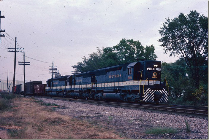 Southern 3119-3131-3155 (all SD45s) head onto their own track with e/b freight 111. 09-25-1981.