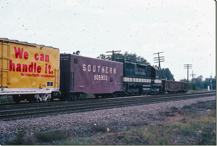 "Southern ""Slave"" SD35 3084 was 50 cars deep in the 90-car train."