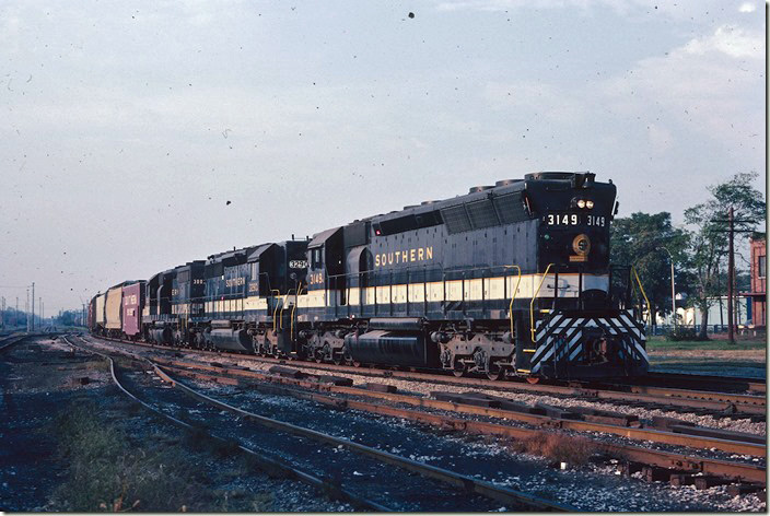 Southern 3149-3290-3003 have just crossed ICG (on the left) with w/b freight 1st 128 (flags) and are probably still on the BN. Saturday, 09-26-1981.