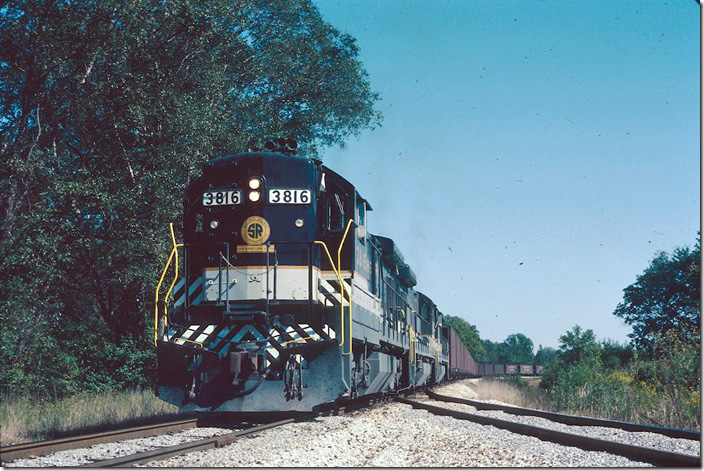 Southern B36-7s 3816-3818-3819 are flood loading at Old Ben Coal, Enosville IN, on the AW&W. AW&W was co-owned by Southern and Old Ben. 09-23-1981.