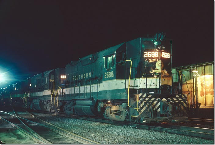 Southern Ry. GP35 2688 and 5025 wait for a crew before proceeding on to Potomac Yard on Dec. 26, 1977. Note the ALCo trucks. Lynchburg VA.