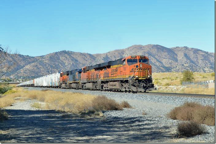 We beat 7800 up to Tehachapi which is about 8 miles. The grade lessens, but the summit is still another 2 miles east. BNSF 7800-6746-596-3841. Tehachapi.