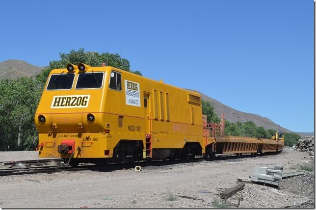 "Parked on a leg of the wye that once formed the branch to Pioche was this Herzog Railroad Services ""Multi Purpose Machine"" for handling scrap ties. According to their web site the HPM can do a wide variety of maintenance jobs."