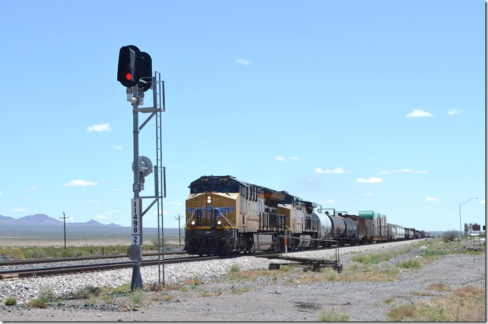UP 2728-7254 sail through town with a w/b freight and intermodal. Lordsburg NM.