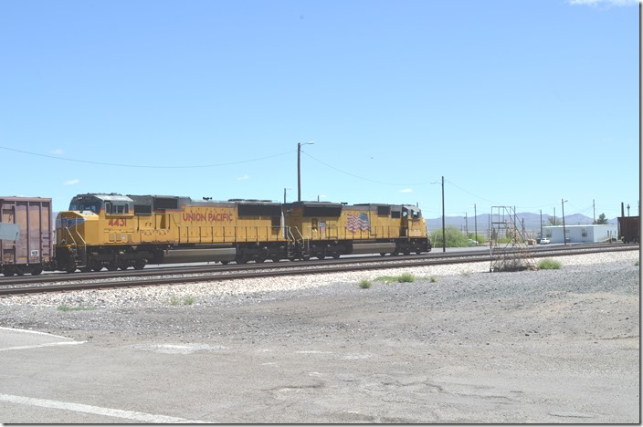 UP doesn't worry about blocking this crossing, as there is an underpass nearby. That's the yard office on the right. UP 4431-5079. View 3. Lordsburg NM.