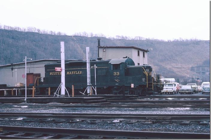 GP9 33 was at the engine terminal. WM was an early advocate of chopping the short nose on their Geeps. WM Ridgeley WV.