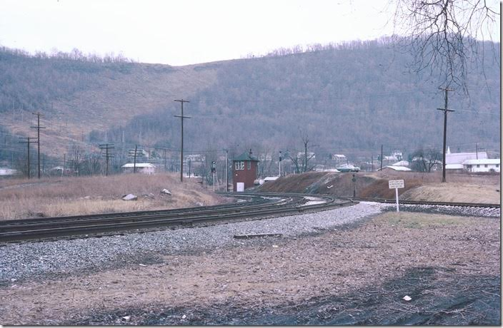 Herb Parsons and I drove over here following our WMSR tour. Everything is gone except the wye which WMSR still uses. All of this has been reclaimed by nature. This view looks railroad east at Maryland Junction tower. The main line to Hagerstown swings to the left and under the mountain through Knobley Tunnel. The track to the right goes west a short distance to Knobmount Yard on the Elkins line where the coal was classified. WM Ridgeley WV.