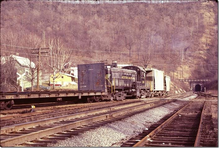 RS-3 moseyed out of Knobley Tunnel heading toward the yard on the Connellsville main. WM Ridgeley WV.