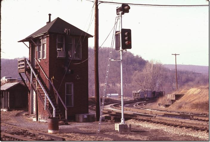 """MY"" controlled the junction. We talked to the operator for a while. He said an eastbound freight would be departing soon. We talked some more and finally left for a shot at the east portal of the tunnel. We had to go back through congested Cumberland and south on Virginia Avenue past the B&O shop to get to the east end of the bridge. WM Ridgeley WV."