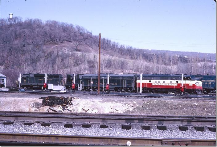 F7a 234 and F7b 403 are on the service track with a lash-up of N&W power. N&W GP30 2906 is ex-NKP. WM Ridgeley WV.